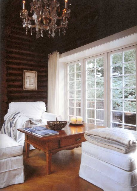 Dark wood log cabin white trim white furniture the Log cabin chandelier