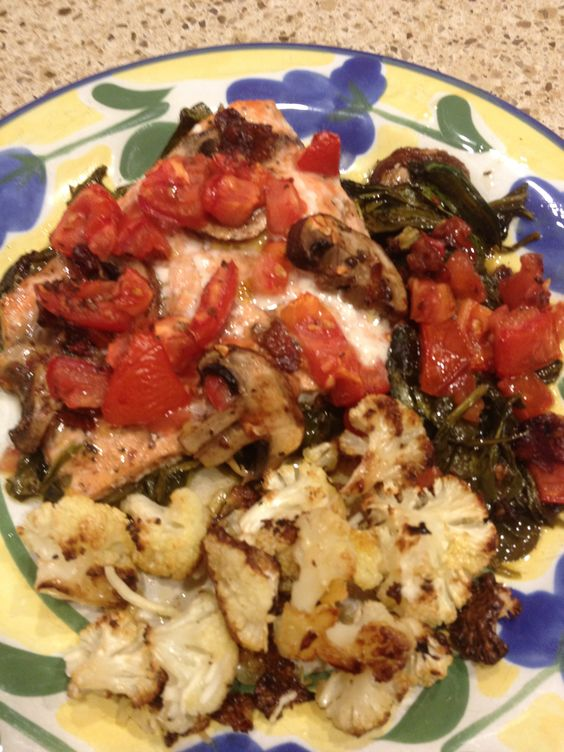 Voila! Dinner is served! (Salmon w/spinach, tomatoes and mushrooms and roasted cauliflower)
