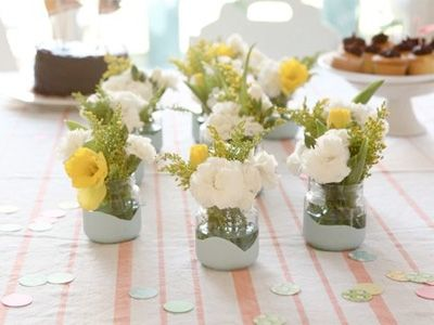 Jars dipped in paint - for the table. I have millions of jars. It would look lovely. Thank you Frankie mag!