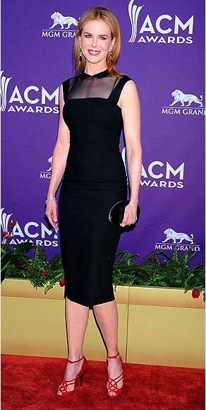 Supporting her country crooner hubby Keith Urban, Nicole Kidman spices up a demure schoolgirl-collared frock with sexy, strappy red sandals (both by L'Wren Scott) and Cartier gems. Source: http://www.people.com/people/package/gallery/0,,20267558_20583655,00.html#21141486
