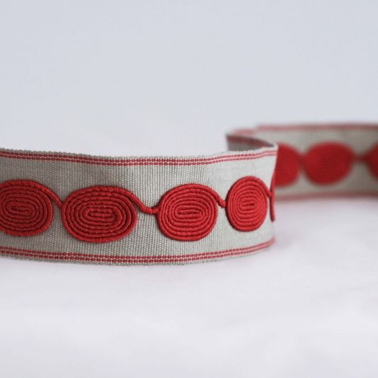 for family room; Oval Braid  A medium sized woven braid with with embroidered ovals in coral on beige.