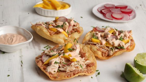 Check out this recipe for easy, homemade Chipotle Chicken and Mango Tostadas. Process bouillon mixture, onion, cilantro, chipotle, sugar and garlic in food processor until smooth. Combine 1 tbsn sauce with Mayonnaise and lime juice. Combine remaining sauce with chicken and marinate 30 minutes in the refrigerator. Grill chicken until thoroughly cooked, then shred. Spread beans on tostadas and top with chicken, mango and radish. Drizzle with mayonnaise mixture and garnish with cilantro.