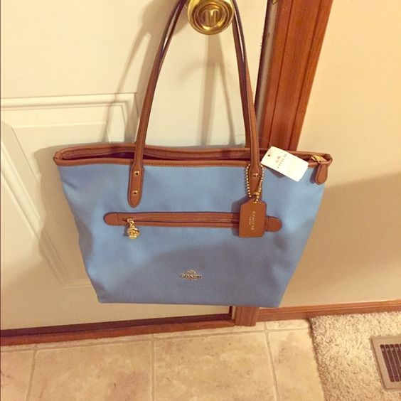 Coach purse blue canvas brand new!! Nwt coach blue canvas medium  bag with leather trim and leather handles and bottom! Brand new just small for me I like large bags! Coach Bags Shoulder Bags