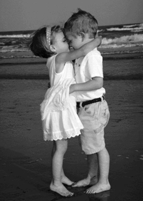 Kids Kissing On Beach