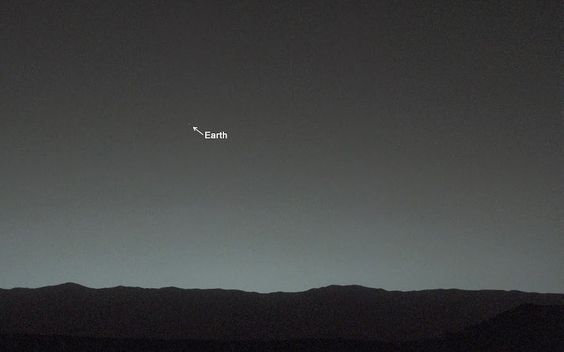 This view of the twilight sky and Martian horizon taken by NASA's Curiosity Mars rover includes Earth as the brightest point of light in the night sky. Earth is a little left of center in the image.