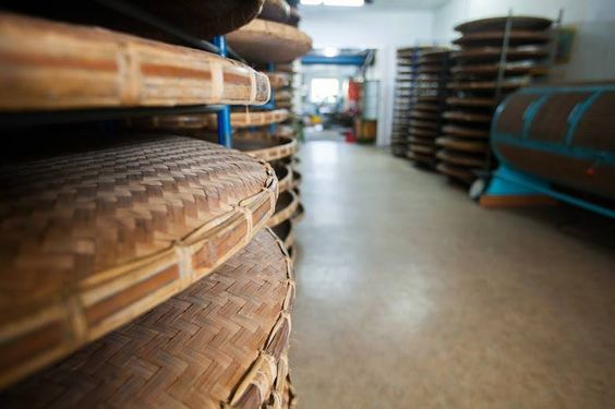 Woven bamboo tea trays in the Lin family's newly constructed organic oolong tea factory in their home. The factory uses all second-hand equipment.  #tea #oolong #taiwan #organic #secondhand
