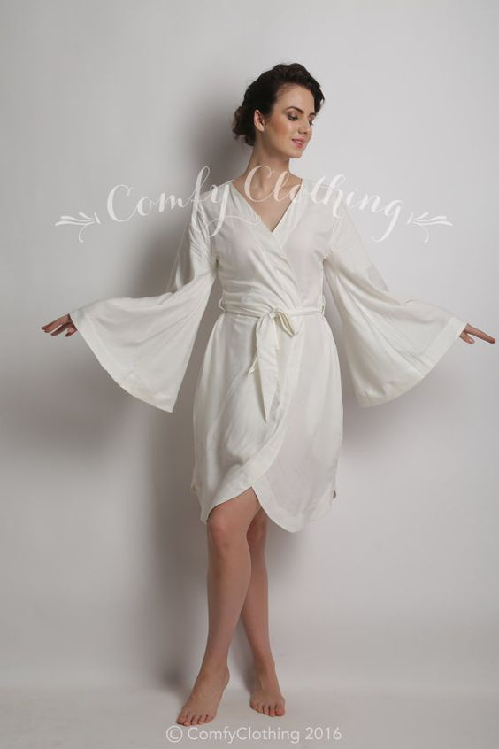 White Bridal robe for the Bride. Design code A001. Characteristic bell/ flared sleeves, rounded bottom hem and flat collar. Feel like a princess in