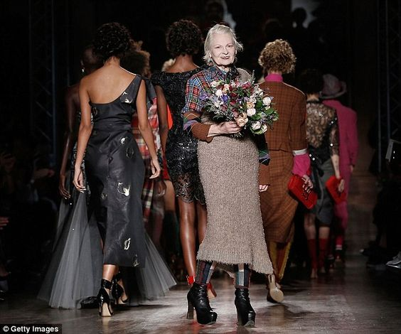 Still reigning supreme: Westwood was presented with a bouquet of flowers following the pre...