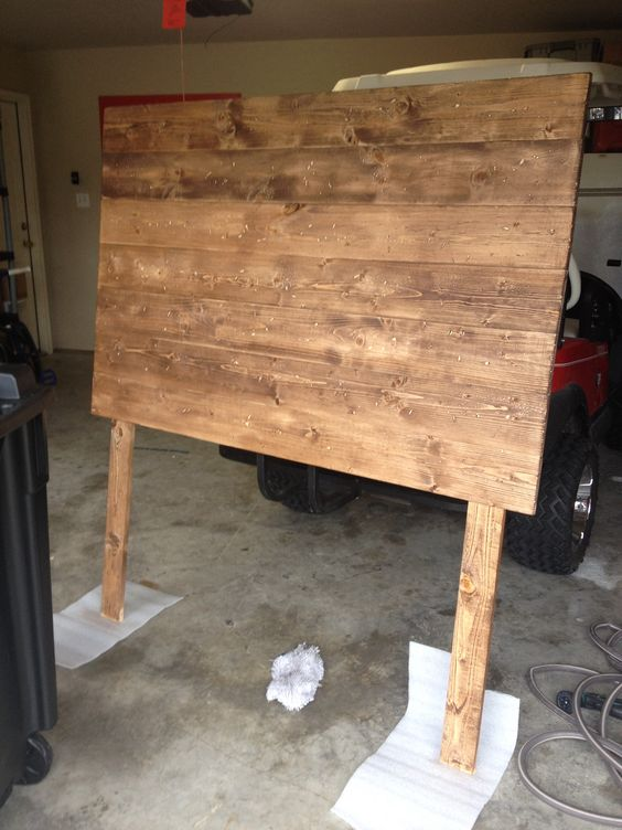 "DIY (full size) headboard.  7 - 1x6x6 boards from Lowe's 2 - 1x4x6 boards from Lowe's  Minwax stain in ""special walnut""  Screw 1x6x6 boards across into the 1x4x6 as legs.   Sand.   Wipe Down.   Stain.  <3"