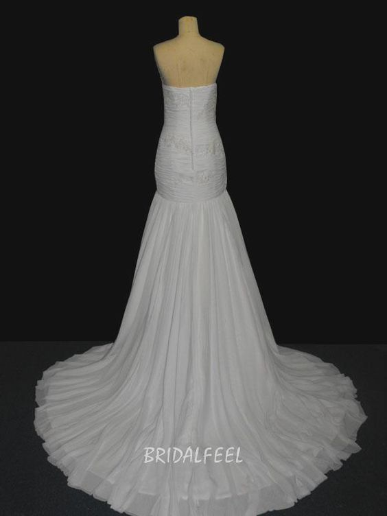 This elegant gown features include, asymmetrical ruched bodice with lace accents and full layered chiffon skirt.