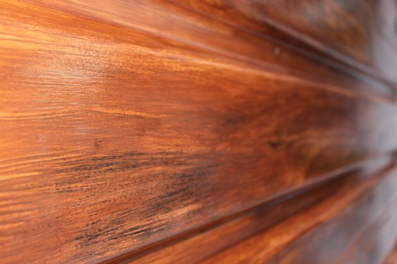 "http://beachbumlivin.com Me doing a ""faux"" wood grain on a garage door."