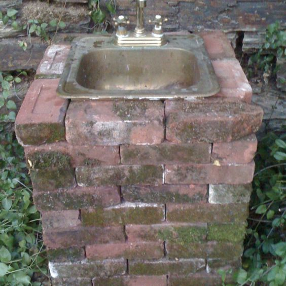 my outdoor sink made from savaged bricks brass sink and. Black Bedroom Furniture Sets. Home Design Ideas