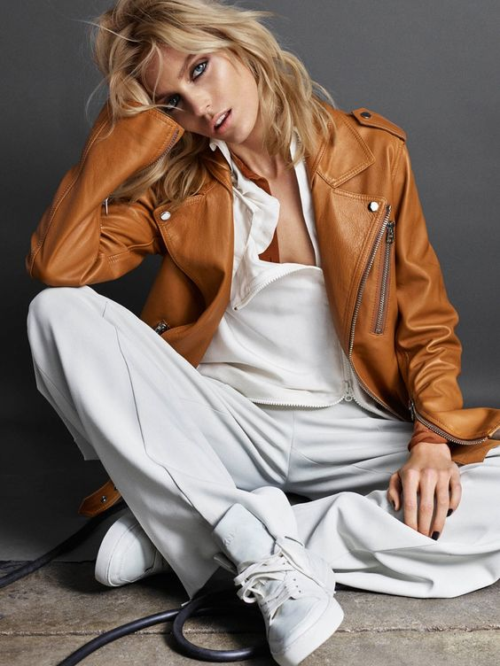 Top model Anja Rubik graces the June 2016 cover of Vogue Portugal, layering up in a tan jacket, navy blouse, pants and sneakers. Inside the magazine, the blonde beauty poses for Hunter & Gatti in transitional looks that go from summer to fall. Stylist Ada Kokosar selects a mix of casual shirting, sneakers, quilted jackets …