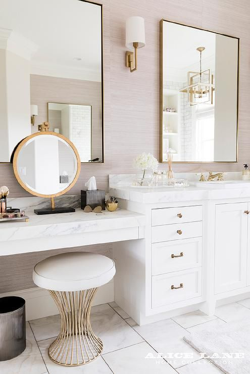 White And Gold Makeup Vanity Paired With A Gold Stool Under A Marble Countertop And A Rou Master Bathroom Design Bathroom Vanity Designs Master Bathroom Vanity