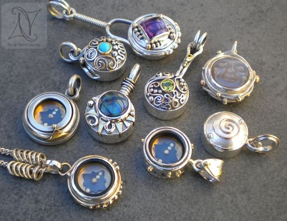Some of my silver and Gold compass creations photographed in our French garden in the evening sun.