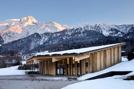 kengo kuma's timber office building sits by the base of mont-blanc