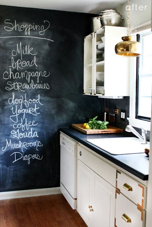 Adding a full chalkboard wall transformed this tiny kitchen...but see that pendant light? Made from a cheapo thrift store bowl and light kit! Entire kitchen made over for under a hundred bucks!