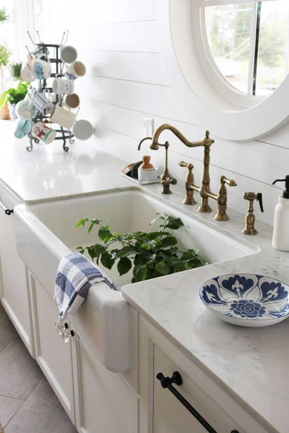 White Quartz Counters with Farmhouse Sink: Carrara Gioia Quartz at Daltile