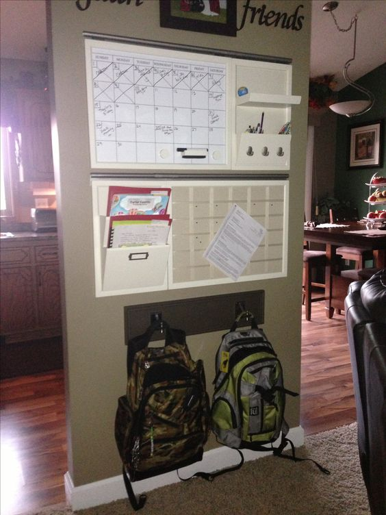 Keep the kids stuff organized with calendar and hooks for the back packs.