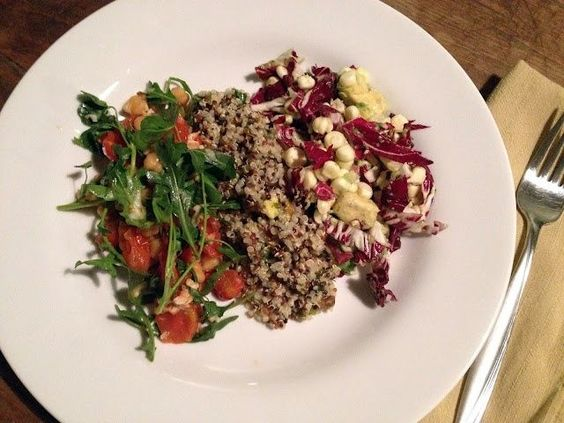 a trio of healthy and simple salads – radicchio with corn and avocado, quinoa with herb vinaigrette and pistachios, garbanzo beans with roasted tomatoes arugula and parmesan