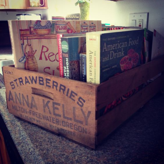 Repurpose old fruit crates for cookbook storage.