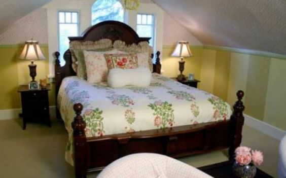 Gorgeous four poster bed with floral spread
