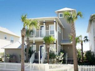 Ocean getaway at the pet friendly Blue Runner in Destin, FL. #palmtrees #beach #beachouse #picketfence
