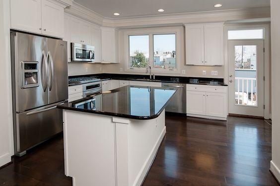 Ooh la la! Striking and neutral kitchen.