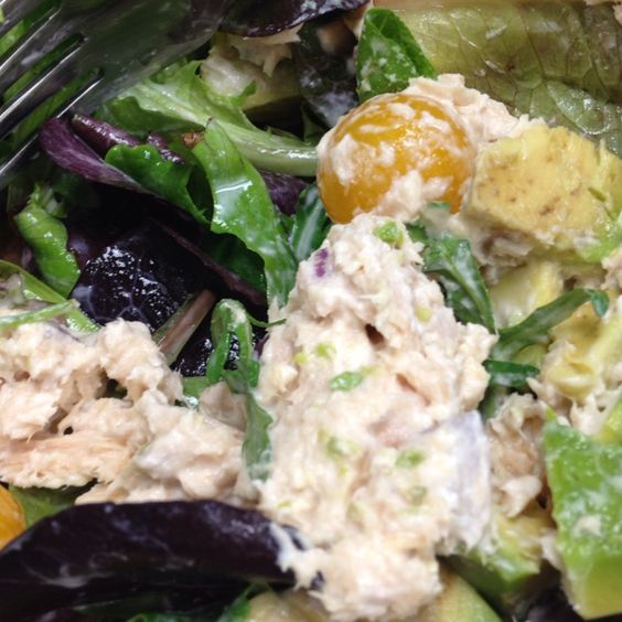 Healthy tuna salad: chunk albacore, honey Greek yogurt, small splash of OJ & diced red onion on a bed of 50/50 spring mix & spinach with avocado & golden cherry tomatoes. Protein and nutrient packed lunch! Yumm!