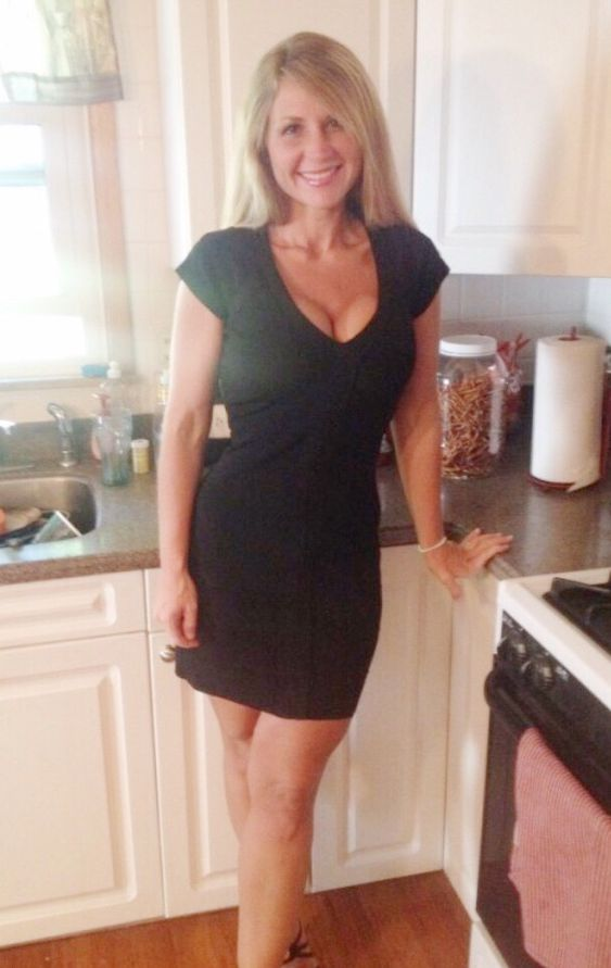 Beautiful Blond Milf In Sexy Black Dress In Kitchen Find