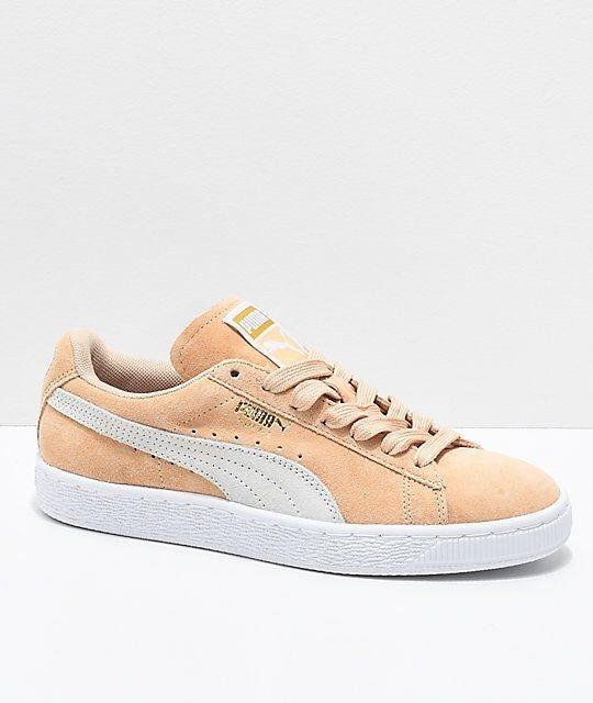 Women's puma shoes that are a peach