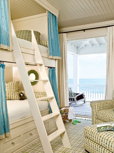 In this beachside bunkroom in South Carolina, a pop of solid color against the small-scale print anchors the space while still keeping the mood light and the look cohesive. The rug picks up on the other blues so that the patterns can coordinate, not clash.