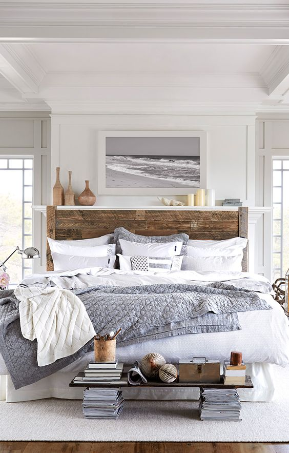 reclaimed wood headboard in white and grey bedroom.: