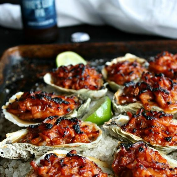 Oysters Kilpatrick Recipe Appetizers with oysters, rock salt, ketchup, worcestershire sauce, thick-cut bacon, hot sauce, lemon, horseradish, lime wedges