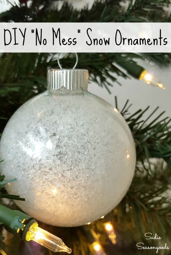 Want a super simple Christmas craft project this holiday season? Simply upcycle some clear ornaments into a no mess snow ornament using this amazing (and kind of CRAZY) craft tutorial from Sadie Seasongoods! You won't believe what she combines to create these sparkly, icy snow ornaments- it's positively GENIUS and won't get glitter all over your house. Get all the DIY details at www.sadieseasongoods.com . #upcycle #Christmas #ChristmasOrnaments #snow #repurpose #Christmascrafts