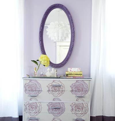 white dresser and purple mirror