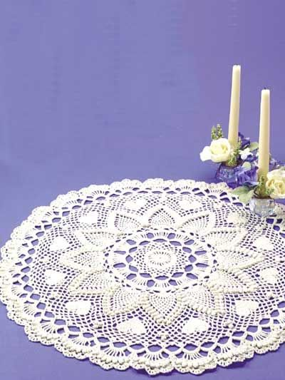 Romantic Pineapples Doily  Create a stunning tabletop centerpiece to welcome guests with this exquisitely detailed doily highlighted with textured pineapples and romantic hearts.  Designed by Jo Ann Maxwell  free pdf from free-crochet.com