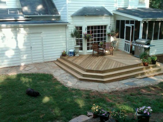 chevron deck with steps and flagstone border.