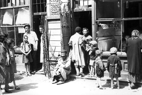 Warsaw ghetto 1941 Poland, Jews standing in storefronts.