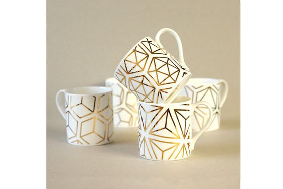 RADSTUDIO!  • 5 minutes ago These awesome hand-decorated white bone china mugs are hand decorated in Stoke-on-Trent with 9 carat gold, talk about having your coffee in style!!! The gold geometric patterns are based on the Platonic Solids, a series of five solid shapes named after the Ancient Greek thinker Plato. The solid shapes are symmetrical, and each is made up of faces that are the same shape. #alfredandwild #goldpainted #saltaire #radstudio #mug #design #gift #christmas