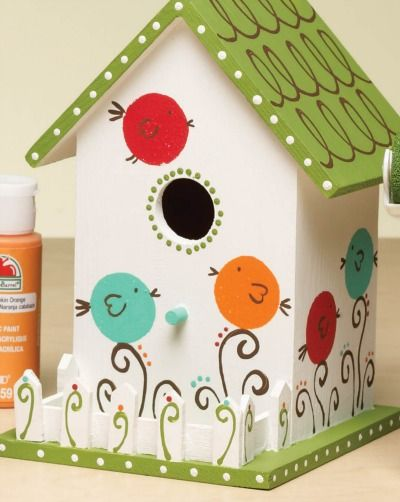 How cute is this DIY birdhouse? Paint your own little birds and designs to match your garden decor.