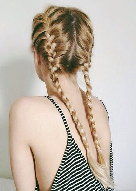 Split your hair evenly down the back. For clean, polished braided pigtails, run some of Alterna's Bamboo Smooth Kendi Oil Dry Oil through your hair. // #Hair: