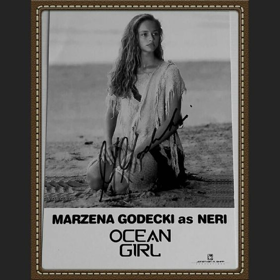 "Marzena Godecki is a Polish-born Australian actress. She is best known for her starring role as Neri in Disney's Ocean Girl.""Ocean Girl"" was filmed in some astoundingly beautiful locations including Australia's Great Barrier Reef and rain forests in Queensland. This delightful Disney TV series ran from 1994 to '97.Ocean Girl was about a young girl who lived on a deserted island. She portrayed an alien/mermaid who befriended a large whale and watched over her friends.Marzena never pursued…"