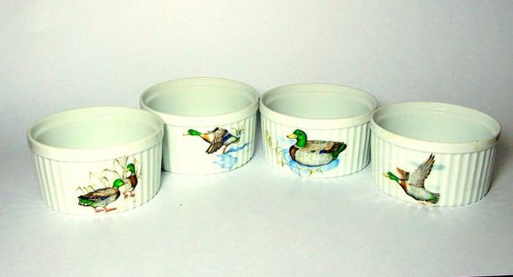Here is a wonderful set of four Mallard ramekins made by Seymour Mann in 1982. These are excellent porcelain ramekins that are oven and