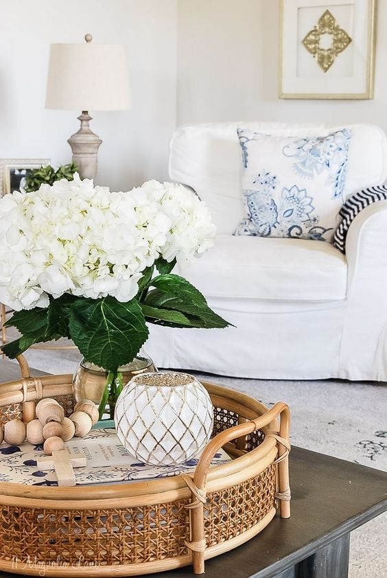 Spring updates with touches of blue in living room decor, coffee table decor with rattan tray and flowers, coffee table styling in family room