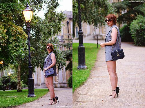 Shop this look on Lookastic:  http://lookastic.com/women/looks/grey-vest-grey-shorts-beige-heeled-sandals-black-crossbody-bag/6071  — Grey Vest  — Grey Shorts  — Beige Leather Heeled Sandals  — Black Leather Crossbody Bag