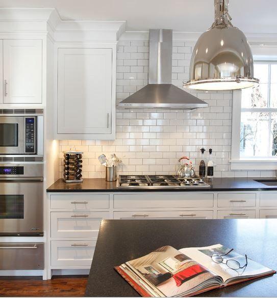 attractive Stainless Steel Kitchen Exhaust Hoods #3: stainless steel kitchen range hood, ovens, tile, cupboards, counter