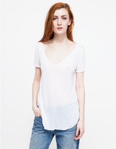 Oversized, relaxed fit tee shirt with a low scooped neckline and exposed edge stitching for an inside out look.