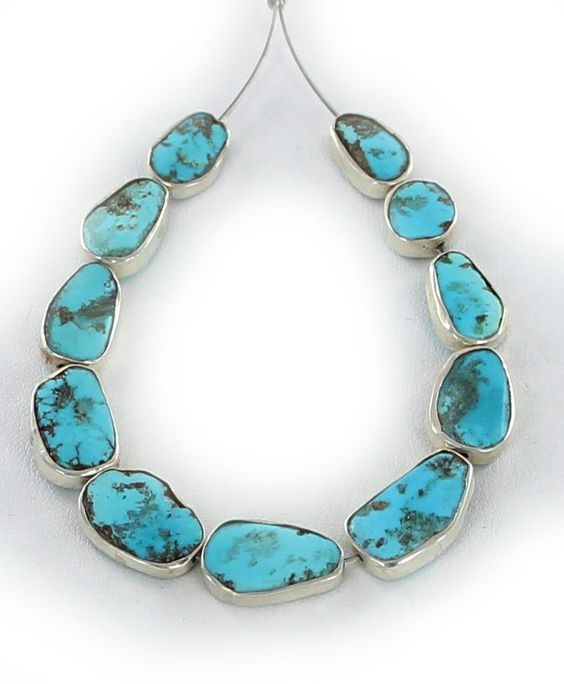 Gorgeous natural Sleeping Beauty Turquoise beads edged in .925 sterling silver. These beauties are perfect for a bracelet or necklace design and range in size from 9mm up to 14x10mm. Sold in a set of