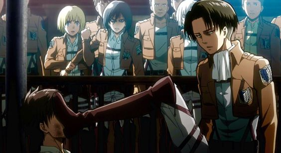 Levi kicking Eren's face in court with Armin, Mikasa, and Rico in the background stands